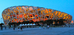 EXTERIOR EVENING NIGHT LIGHTS RED ORANGE GLOW Herzog de Meuron Beijing National Stadium Bird's Nest