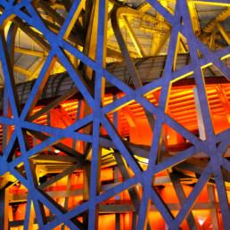 EXTERIOR EVENING NIGHT LIGHTS RED ORANGE GLOW Herzog de Meuron Beijing National Stadium Bird's Nest